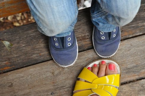 little feet with yellow sandal