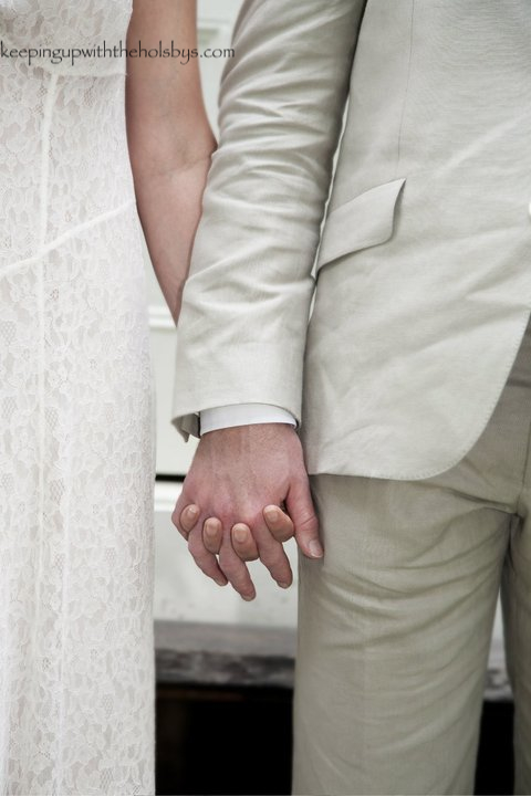 Holding hands on our wedding day